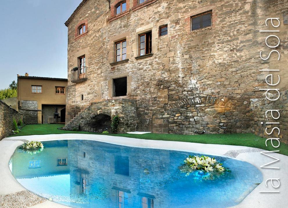 The swimming pool at or close to Fonda La Masia Del Sola