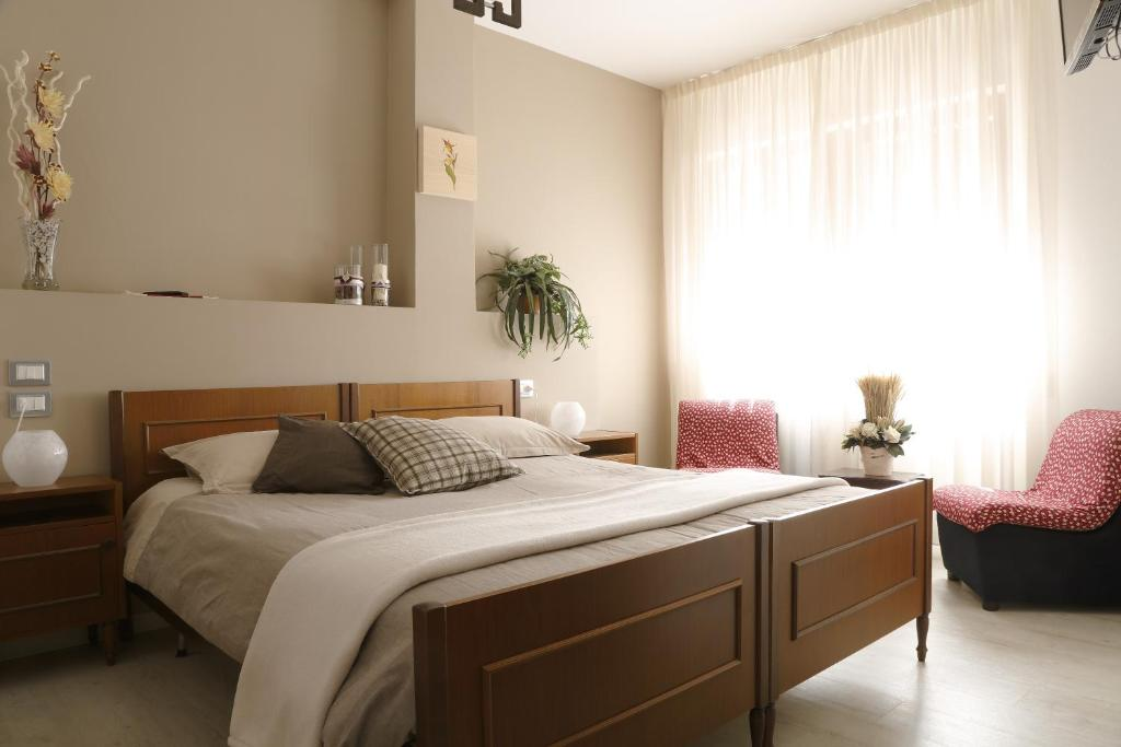 A bed or beds in a room at Al Comune Rustico