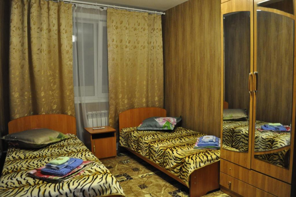 A bed or beds in a room at Guest House Baykalskiy Ochag