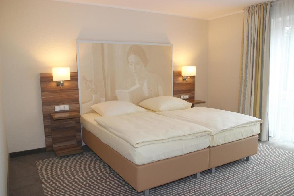 A bed or beds in a room at Balland's Hotel & Restaurant