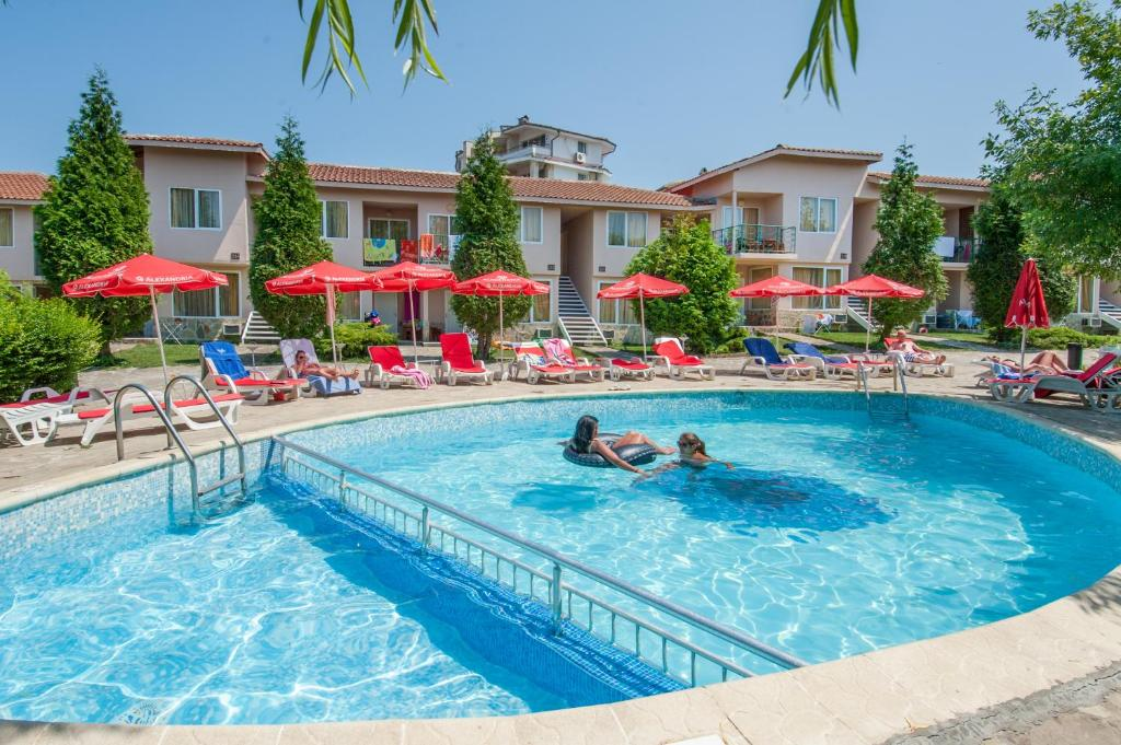 The swimming pool at or near Merlin Club Hotel - All Inclusive
