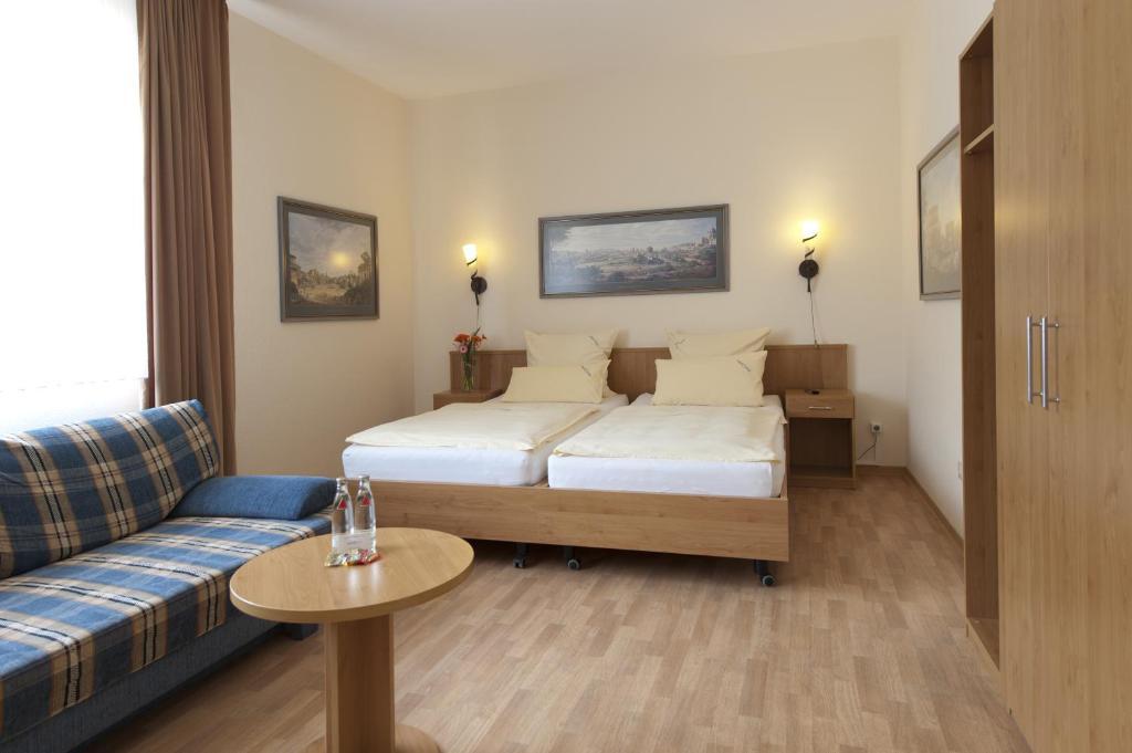 Ein Bett oder Betten in einem Zimmer der Unterkunft Hotel Marco Polo