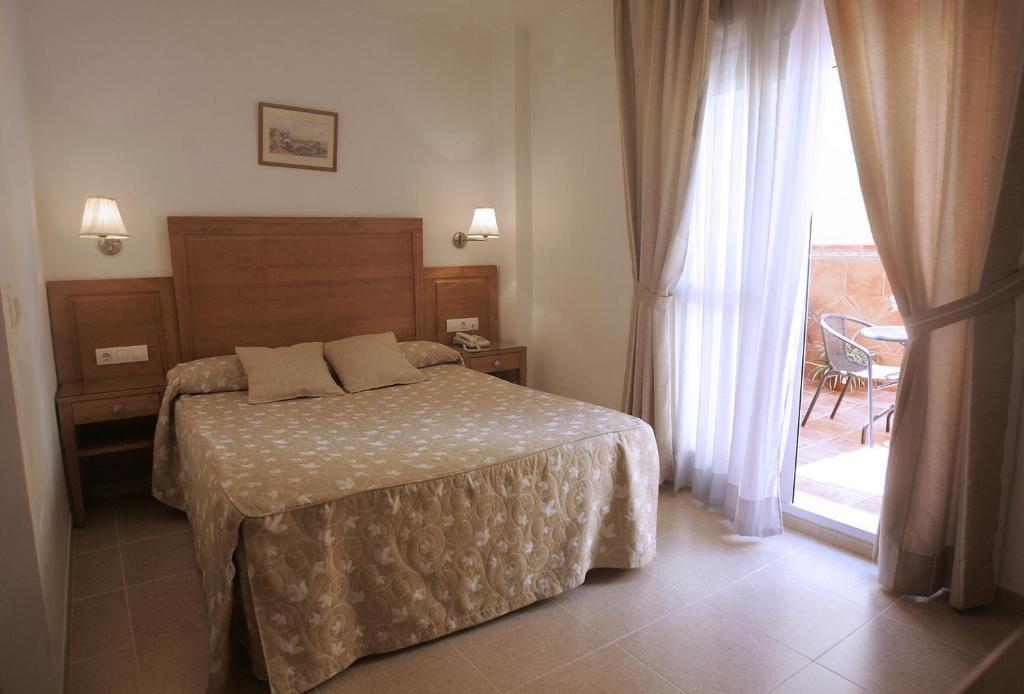 Cama o camas de una habitación en Hotel Goartín