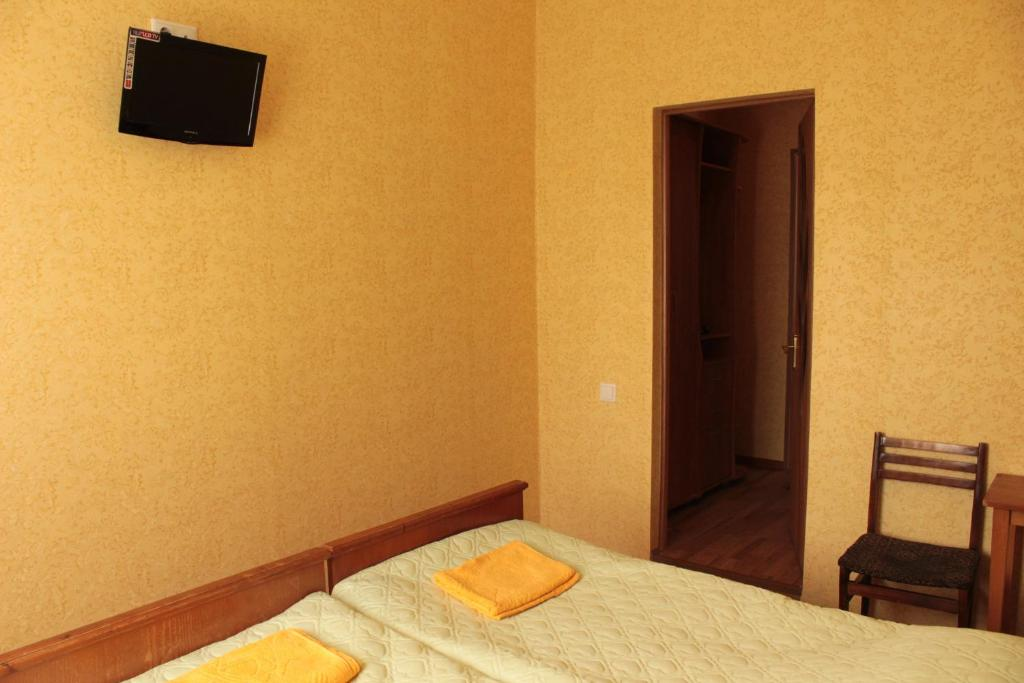 Кровать или кровати в номере Гостевой Дом Ася