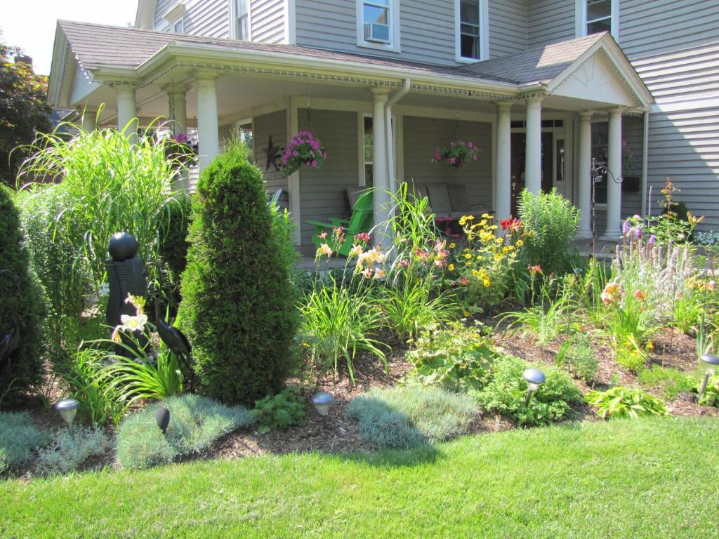 A garden outside In Wolfville Luxury Bed and Breakfast