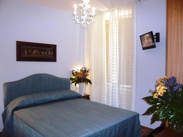 A bed or beds in a room at DolceVitaSorrento Guest House