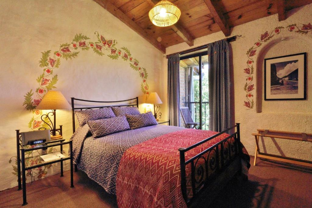 A bed or beds in a room at Hotel Villas Casa Morada