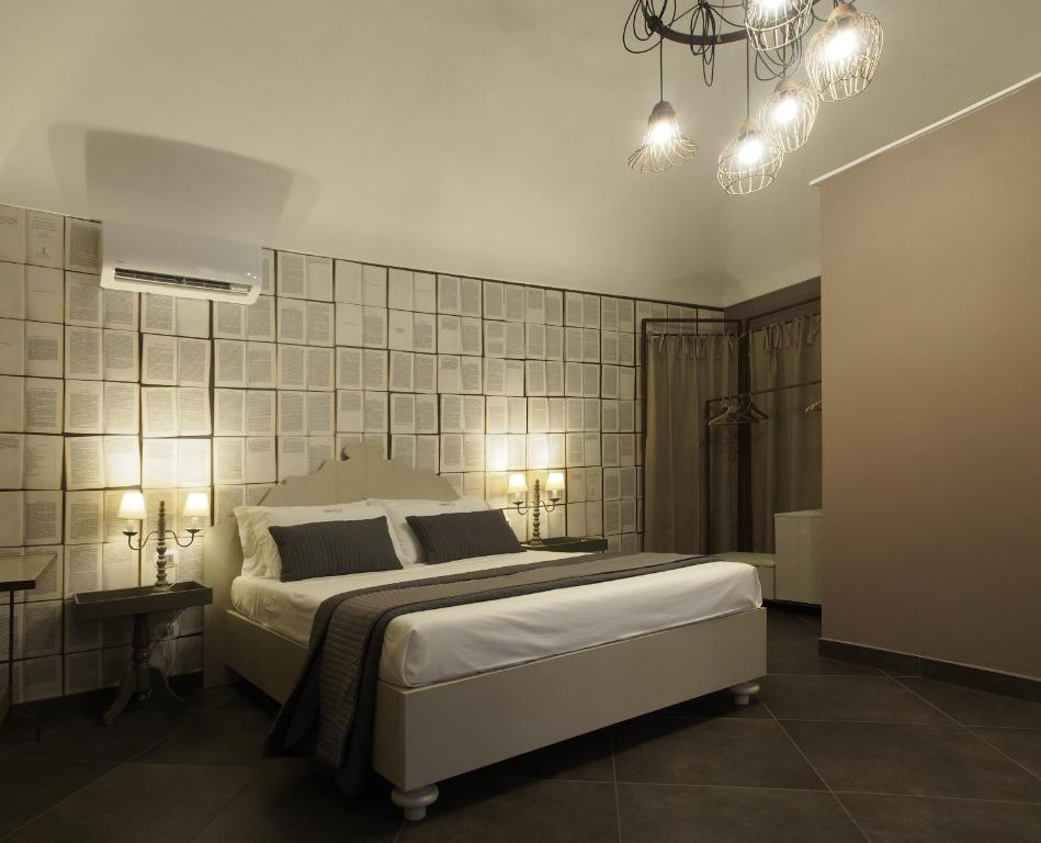 A bed or beds in a room at Terrazzani Suite