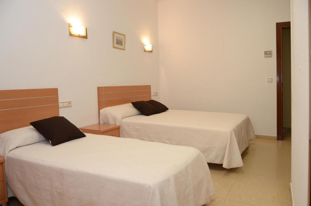 Cama ou camas em um quarto em Pension Canadiense