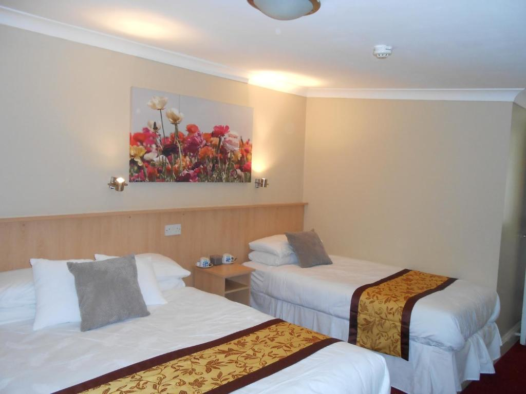 A bed or beds in a room at The Western Strands Hotel