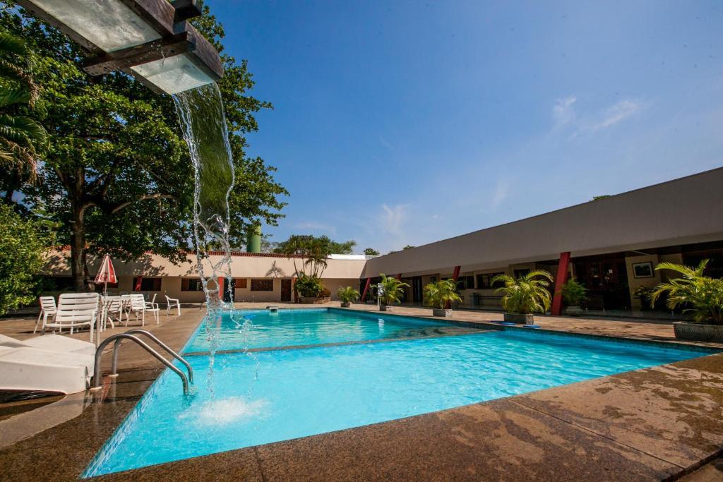 The swimming pool at or near Hotel Fazenda Mato Grosso