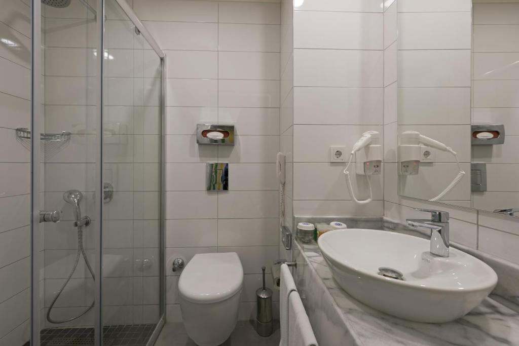 Ванная комната в Hotel Kaptan