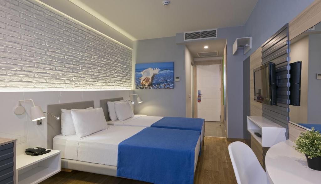 Кровать или кровати в номере Hotel Kaptan