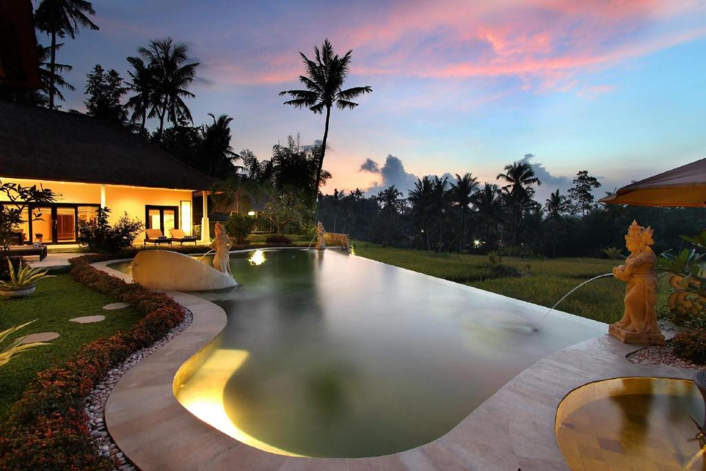 The swimming pool at or near Frangipani Villas