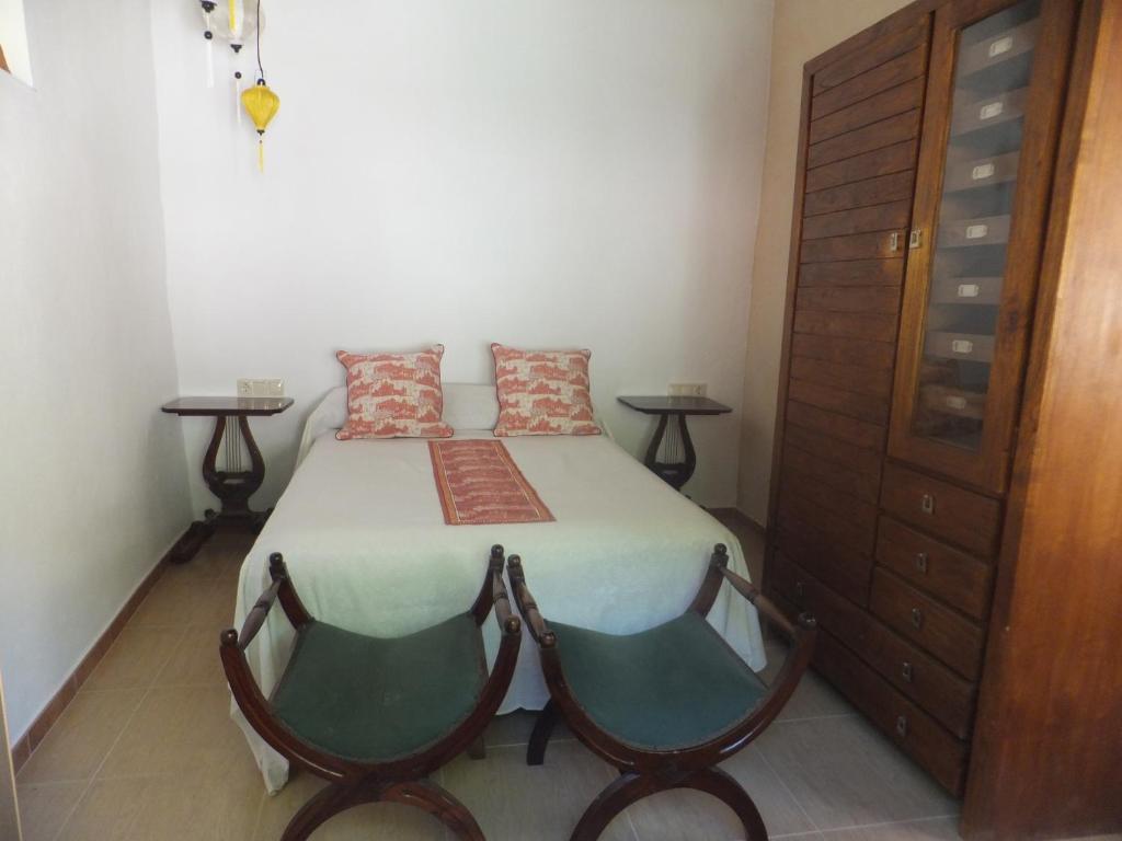 Una cama o camas en una habitación de Río Mundo Alojamiento Rural