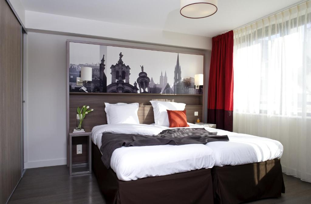 Кровать или кровати в номере Aparthotel Adagio Caen Centre