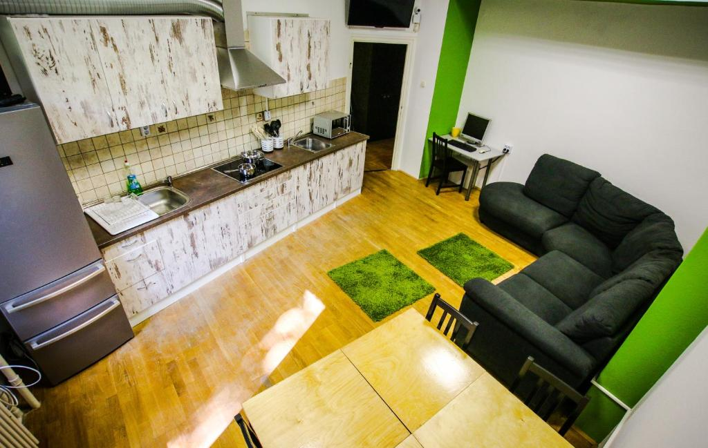 A kitchen or kitchenette at CoolTour Hostel