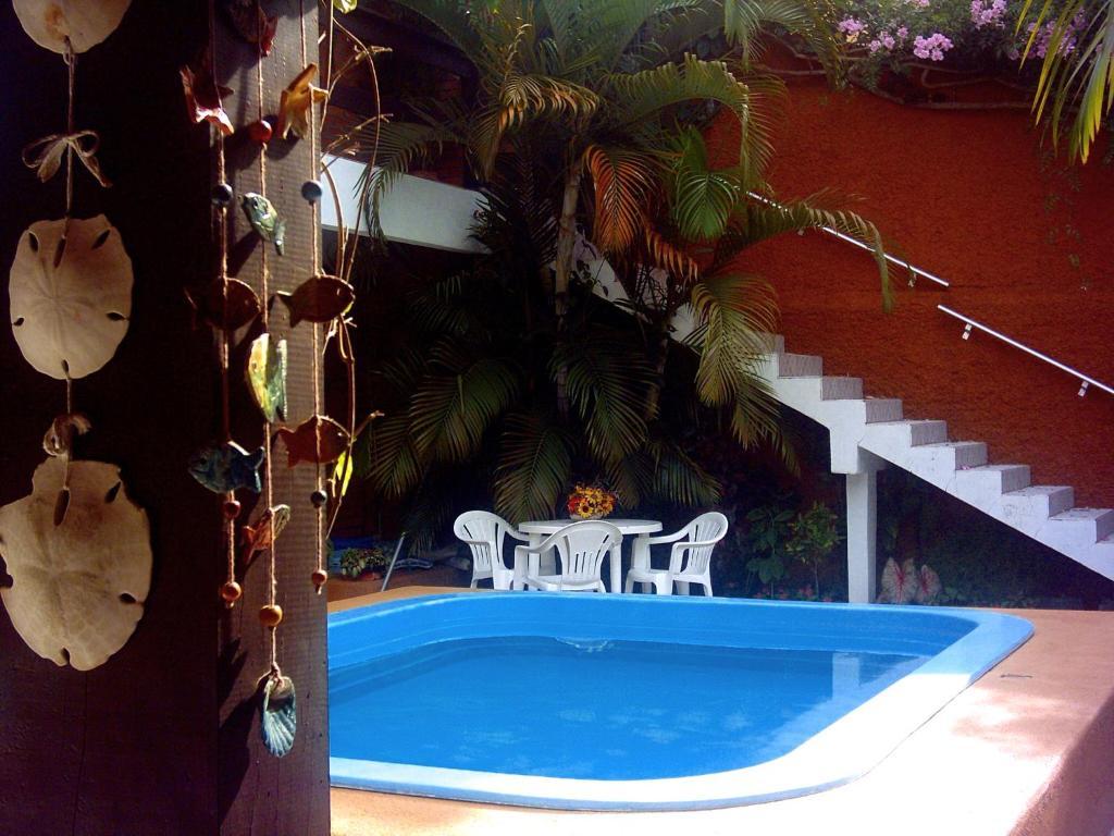 A piscina localizada em Pousada do Beijaflor ou nos arredores