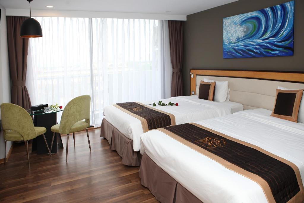 Phòng Deluxe 2 Giường đơn Nhìn ra cảnh Biển của Thành phố
