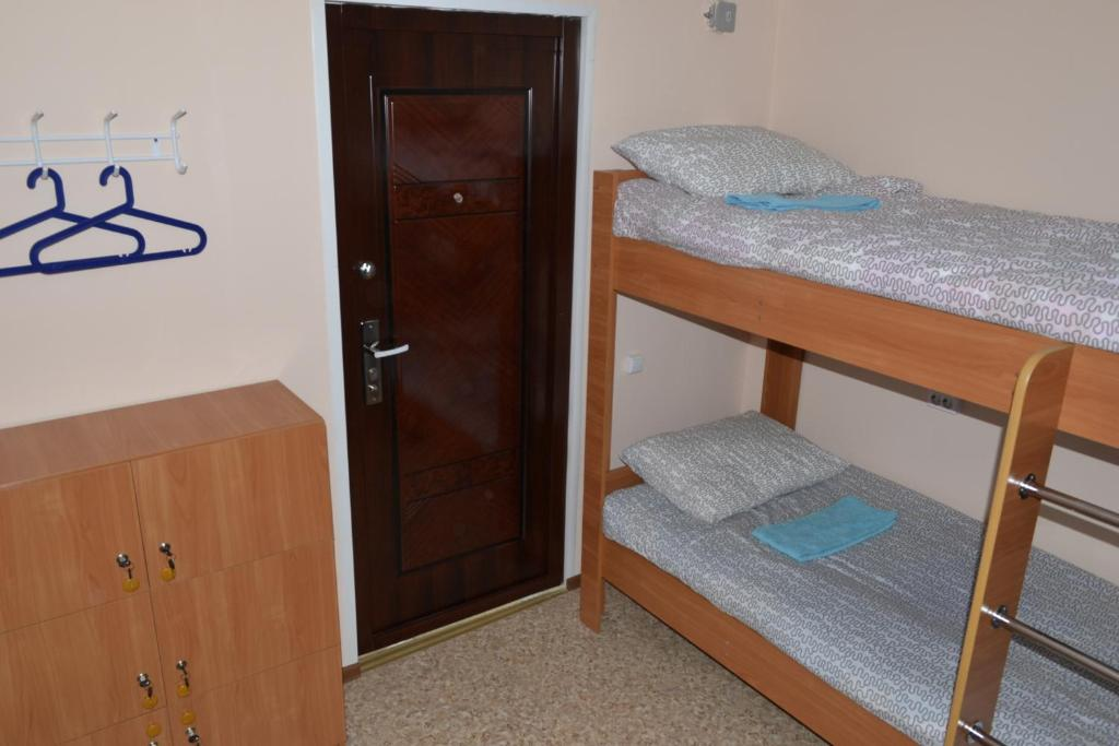 A bunk bed or bunk beds in a room at Hostel Tulka