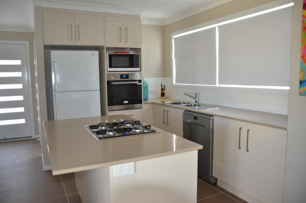 A kitchen or kitchenette at Bunya Vista Accommodation