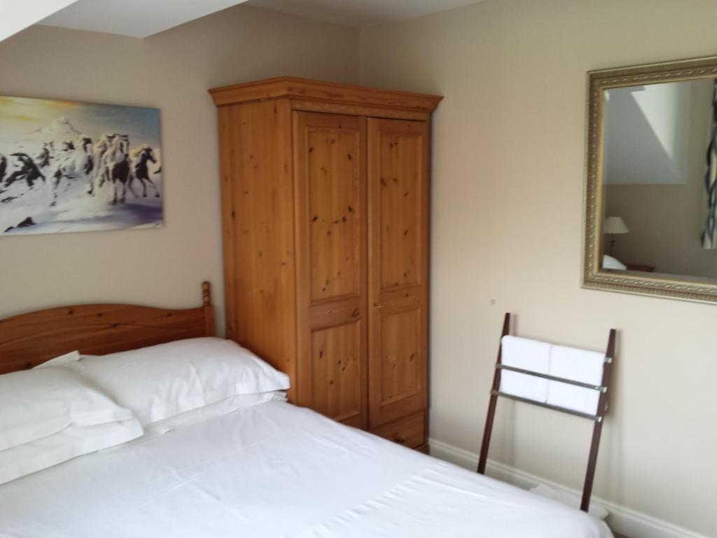 A bed or beds in a room at Glenade