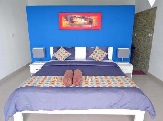 A bed or beds in a room at Kartika Villas