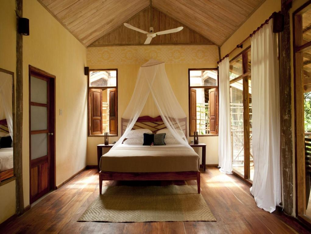 A bed or beds in a room at My Dream Boutique Resort