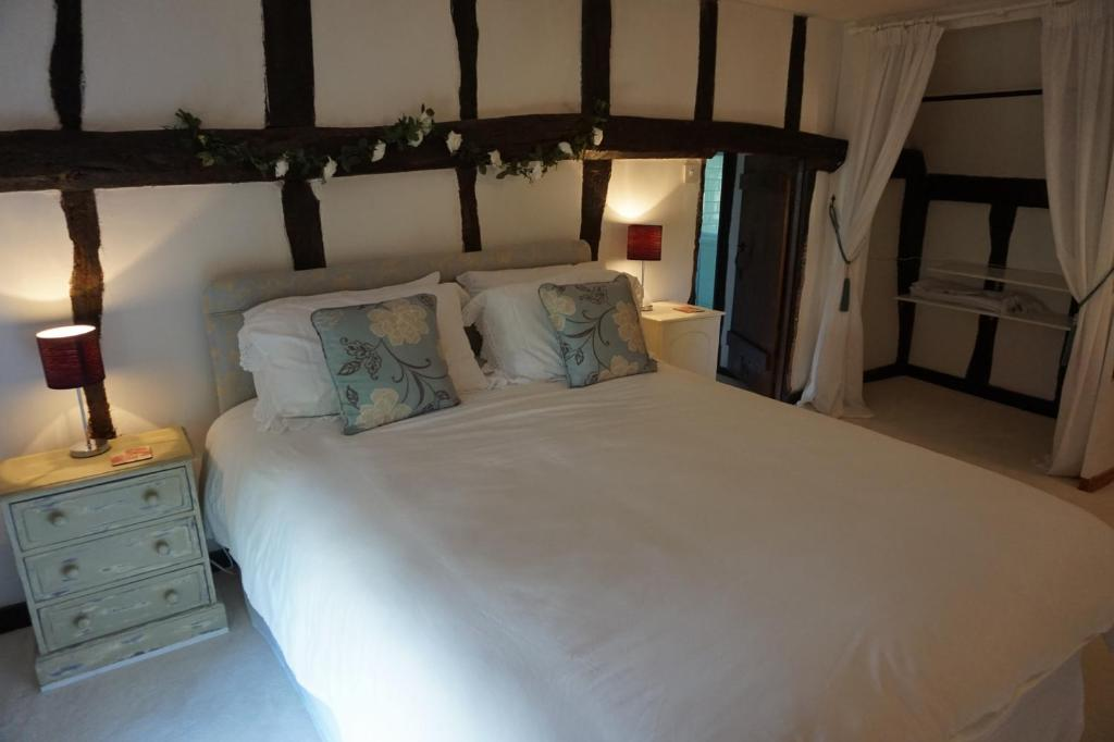A bed or beds in a room at Clay Hall House B&B