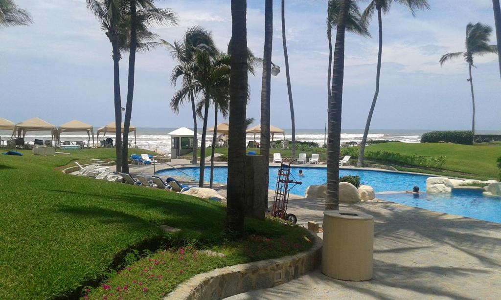 A view of the pool at Mayan Playa TORRE I or nearby