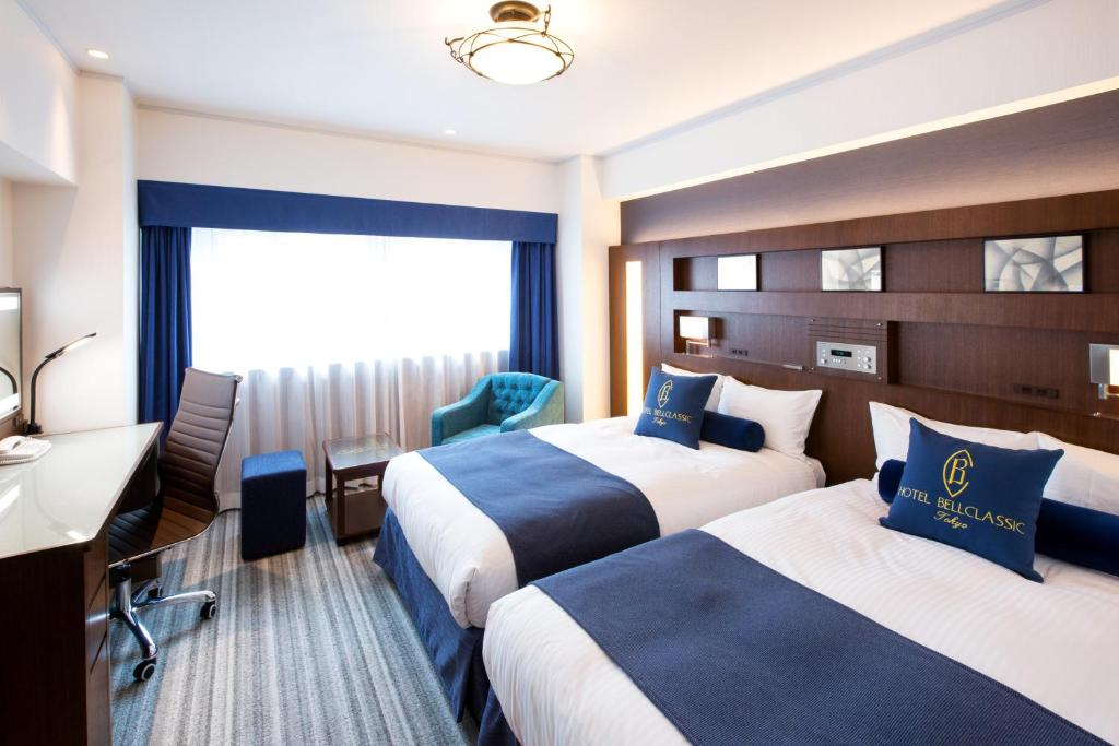 A bed or beds in a room at Hotel Bellclassic Tokyo
