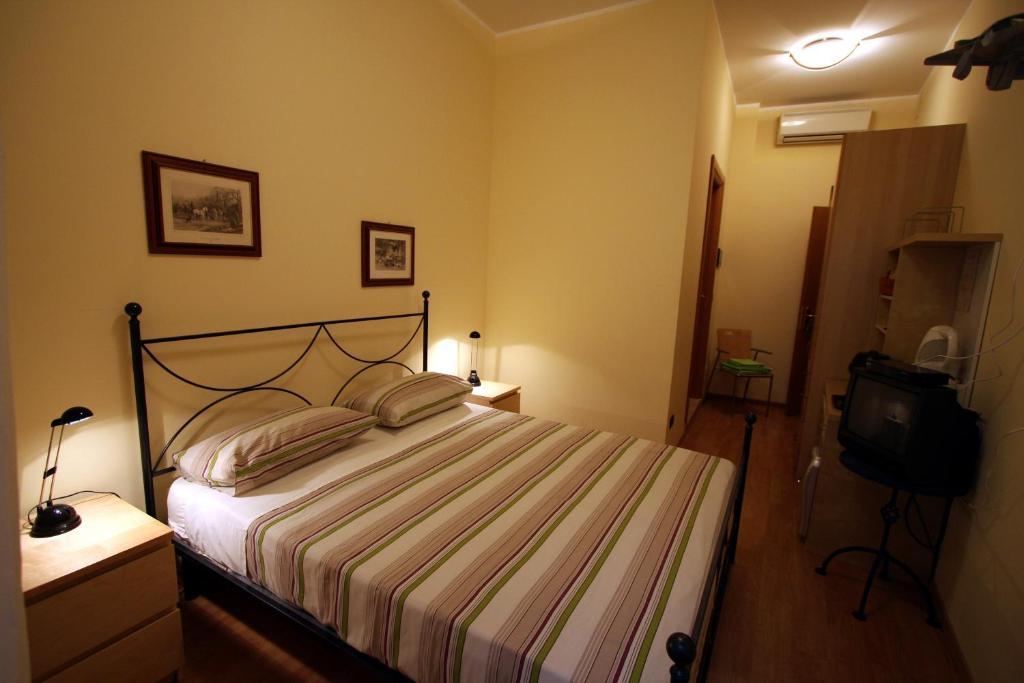 Een bed of bedden in een kamer bij Bed and Breakfast Centrostorico