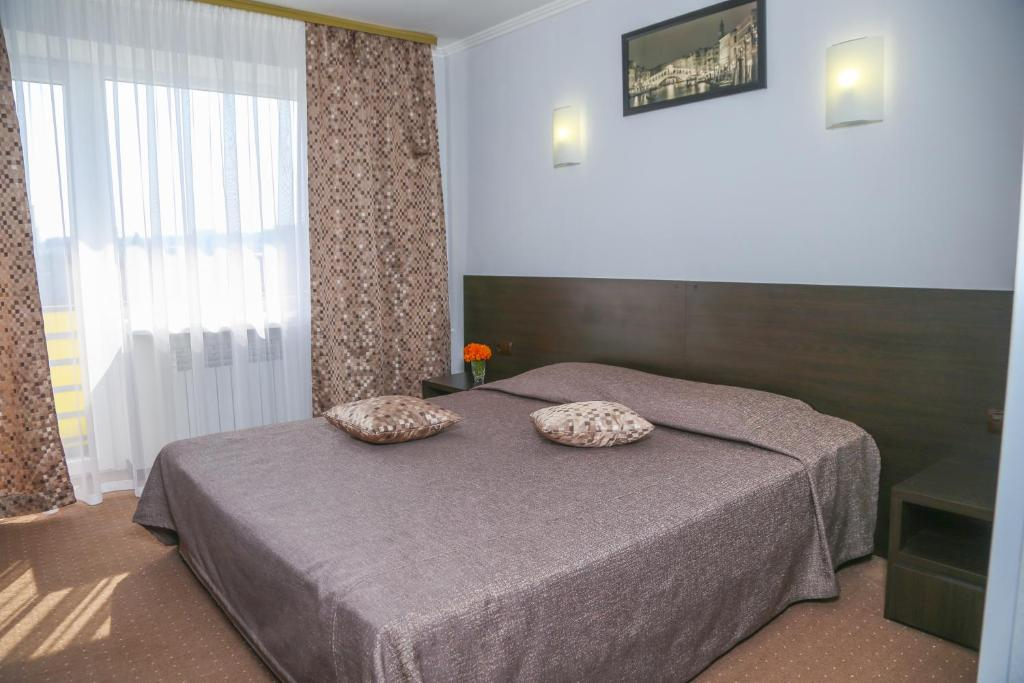 A bed or beds in a room at Dnepropetrovsk Hotel
