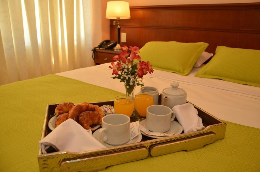 Una cama o camas en una habitación de RealNoa Hotel