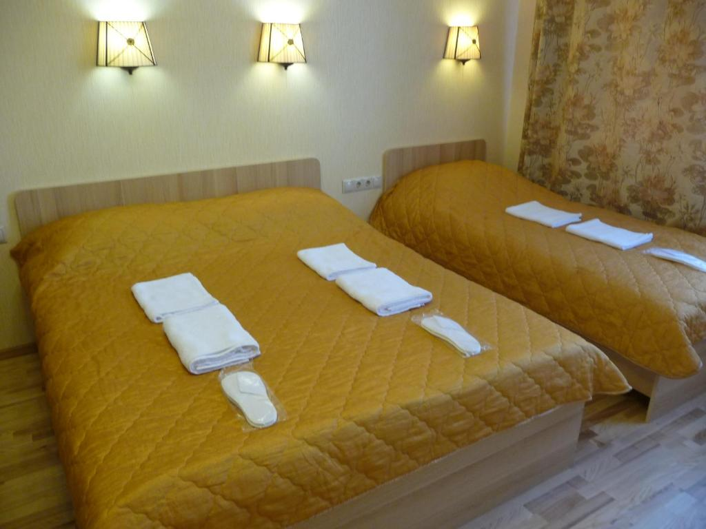 A bed or beds in a room at Apartments Krasnogorsk Expo Crocus