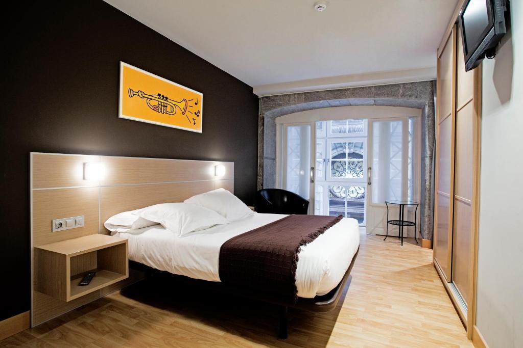 Cama o camas de una habitación en Pensión Arriaga