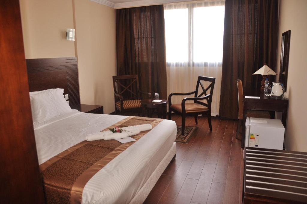 A bed or beds in a room at Central Hotel Tana