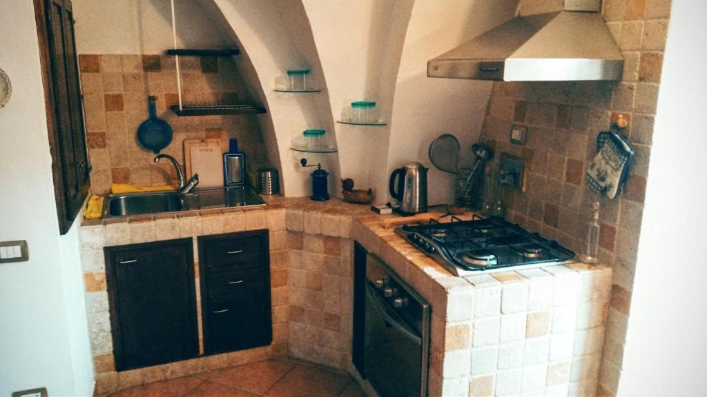 A kitchen or kitchenette at Residenza Le Volte Degli Angeli