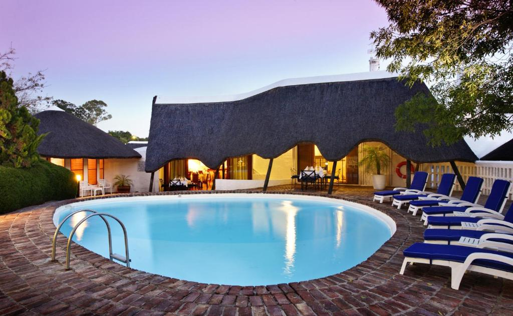 The swimming pool at or near Protea Hotel by Marriott Oudtshoorn Riempie Estate