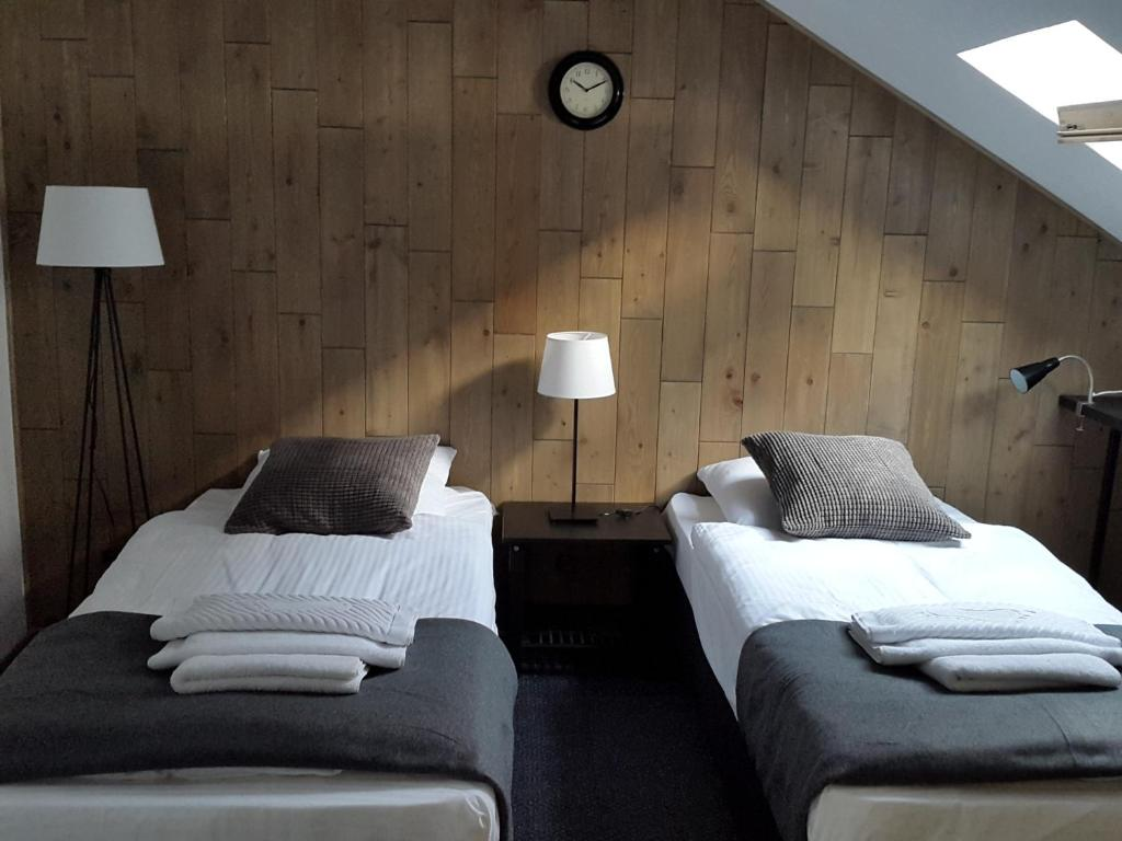 A bed or beds in a room at PEOPLE Loft Tverskaya Hotel