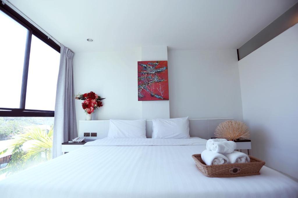 เตียงในห้องที่ Neca Complex Apartment