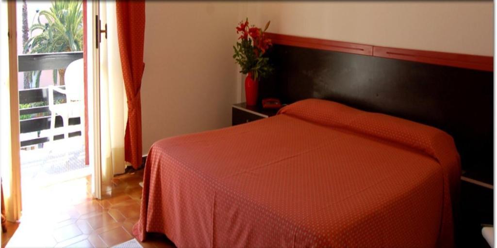 Letto o letti in una camera di Hotel La Playa