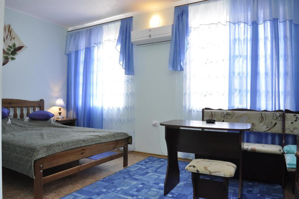 A bed or beds in a room at Hotel Elit Uyut