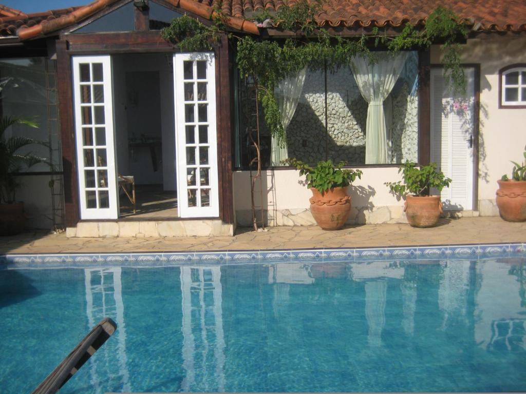The swimming pool at or near Guest House Green Garden