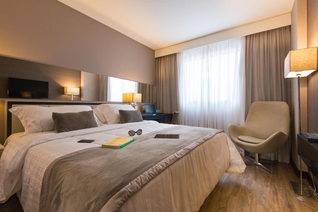 Tempat tidur dalam kamar di Hotel Atlantico Prime