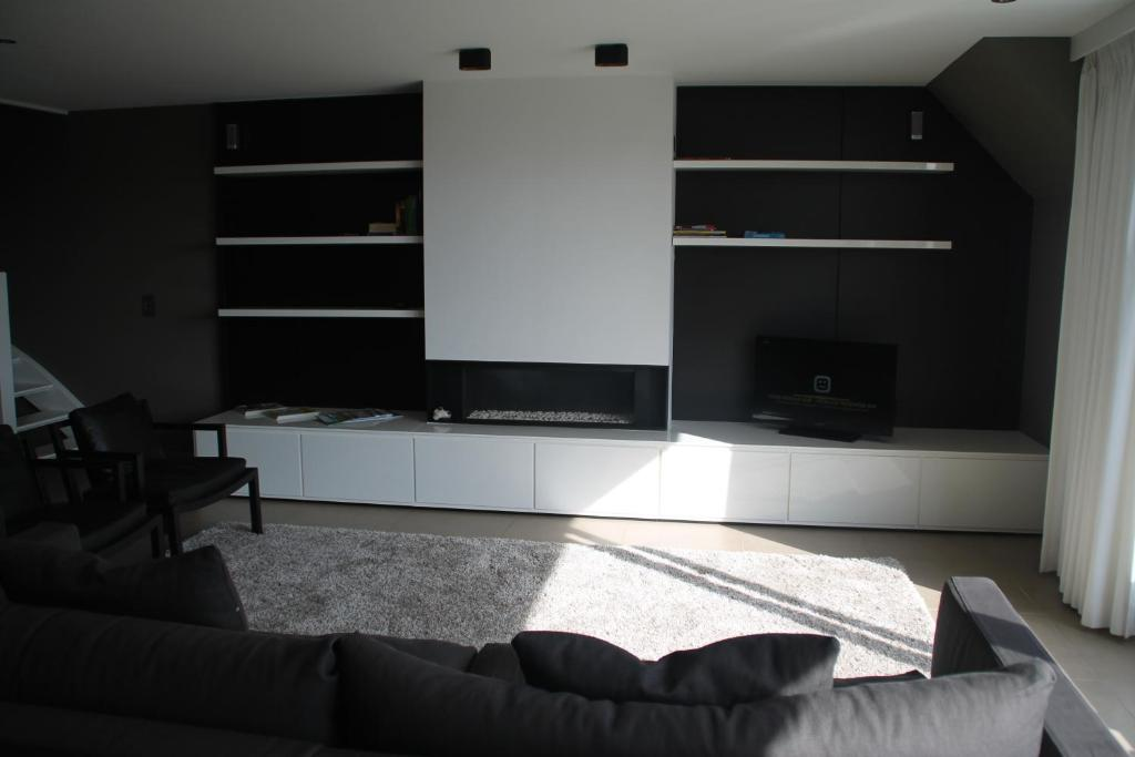 Een TV en/of entertainmentcenter bij Pagnaert Apartment