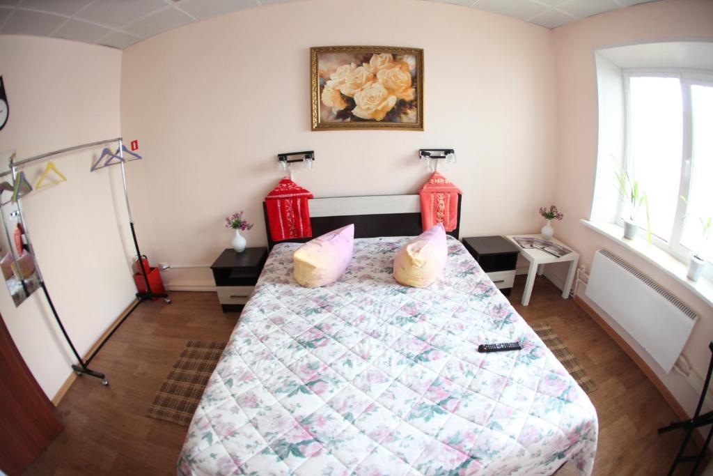Кровать или кровати в номере Велес Хостел