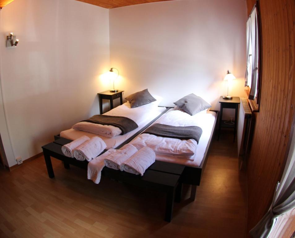 Ein Bett oder Betten in einem Zimmer der Unterkunft La Pierre à Catillon
