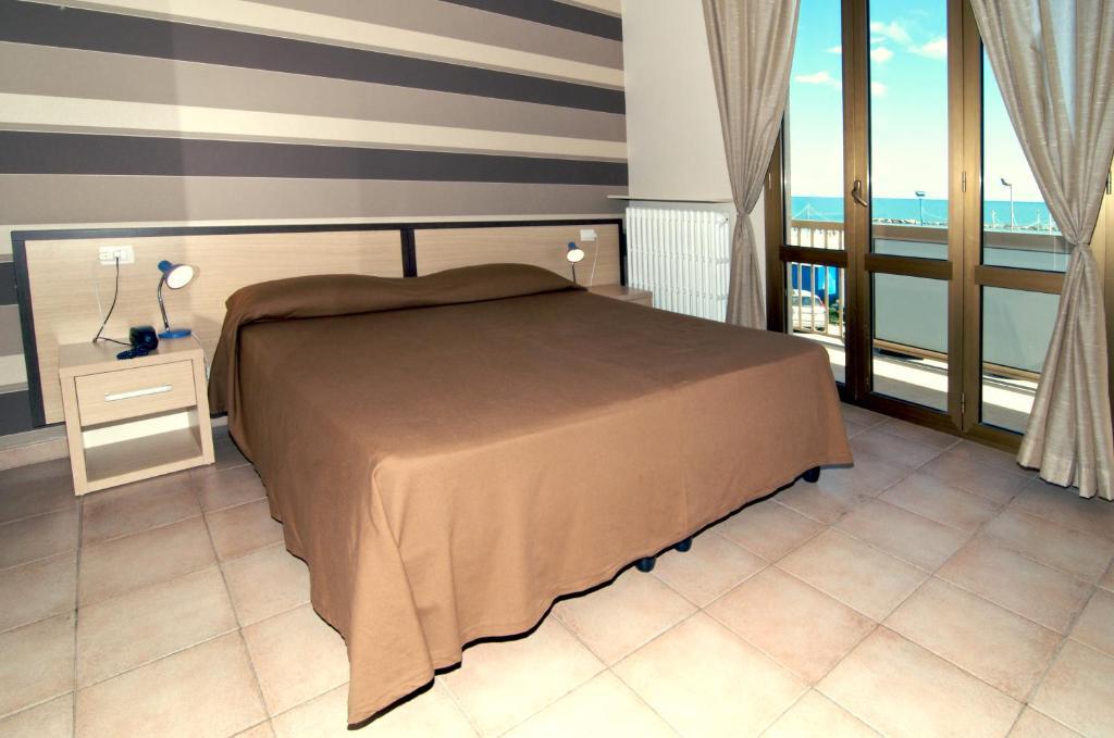 Letto o letti in una camera di Hotel Velus
