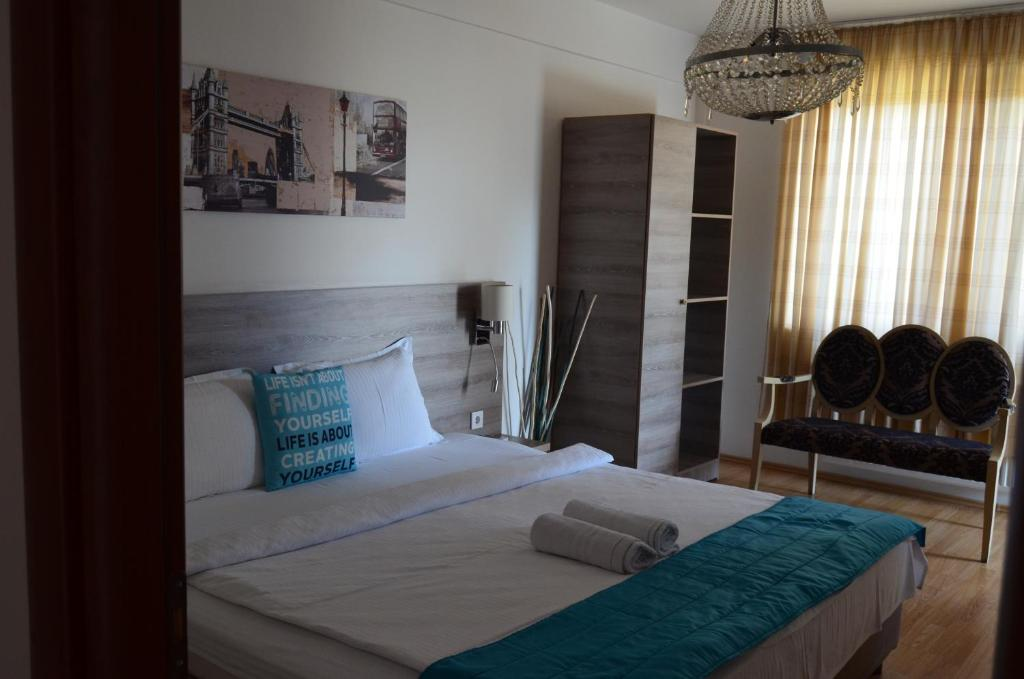 Postel nebo postele na pokoji v ubytování H'otel Korall Residence
